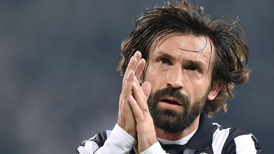 FILE - This is a Sunday, Jan. 18, 2015   file photo of Juventus' Andrea Pirlo as he reacts during a Serie A soccer match between Juventus and Hellas Verona at the Juventus stadium in Turin, Italy. Italy playmaker Andrea Pirlo has joined Major League Soccer club New York City FC from Juventus. Juventus confirmed the news on its official Twitter account Monday July 6, 2015. (AP Photo/Alessandro Di Marco, Ansa) ITALY OUT