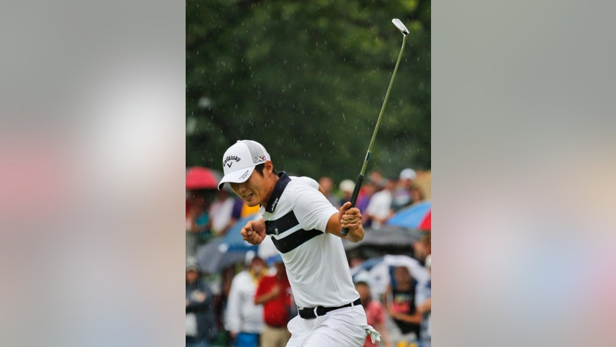 Danny Lee, of New Zealand, reacts to a birdie putt on the 18th green of the first playoff hole at the Greenbrier Classic golf tournament at the Greenbrier Resort  in White Sulphur Springs, W.Va., Sunday, July 5, 2015.  Lee won the tournament on the second playoff hole with David Hearn. (AP Photo/Steve Helber)
