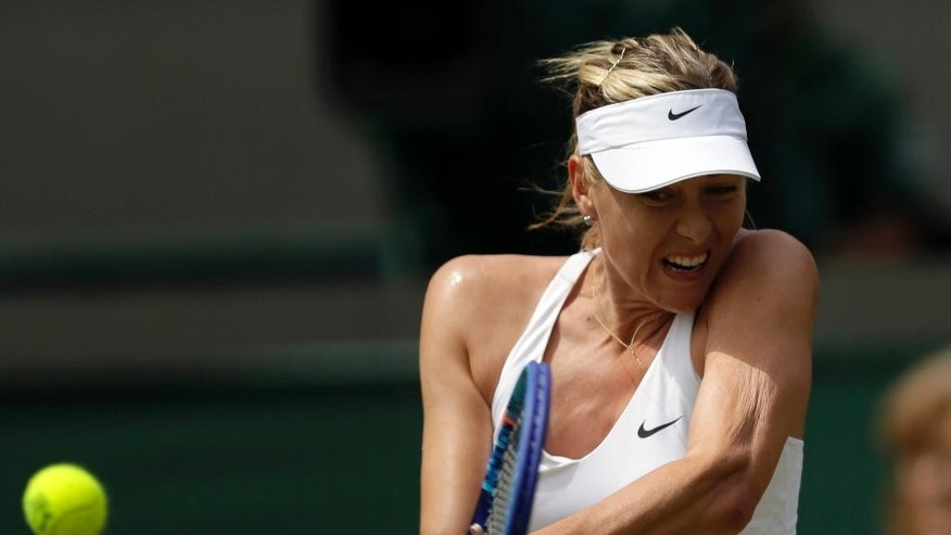 Maria Sharapova of Russia makes a return to   Zarina Diyas of Kazakhstan  during their singles match at the All England Lawn Tennis Championships in Wimbledon, London, Monday July 6, 2015. (AP Photo/Tim Ireland)