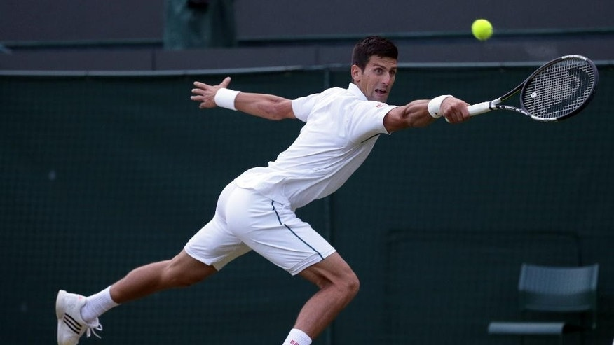 Novak Djokovic of Serbia returns a ball to  Kevin Anderson of South Africa during their singles match against at the All England Lawn Tennis Championships in Wimbledon, London, Monday July 6, 2015. (AP Photo/Tim Ireland)