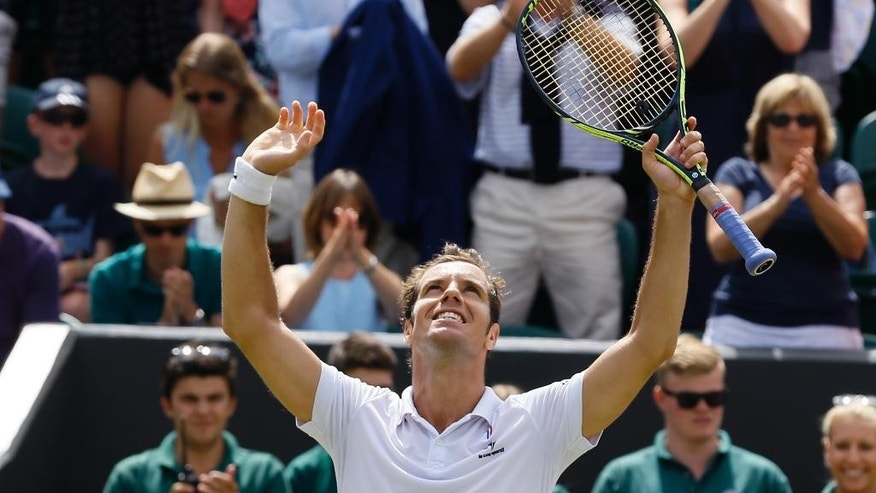Richard Gasquet of France celebrates winning the singles match against Nick Kyrgios of Australia, at the All England Lawn Tennis Championships in Wimbledon, London, Monday July 6, 2015. Gasquet won 7-5, 6-1, 6-7, 7-6. (AP Photo/Kirsty Wigglesworth)