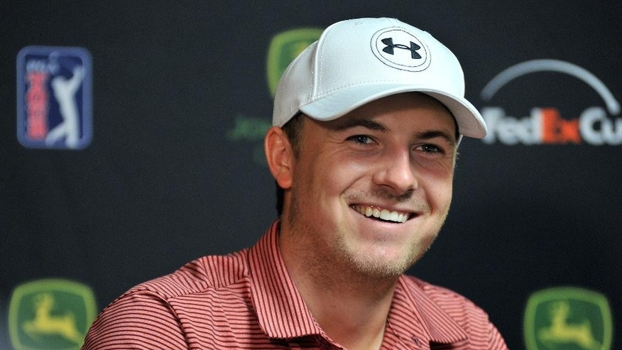 PGA golfer Jordan Spieth answers questions during a news conference at the John Deere Classic, Tuesday, July 7, 2015, in Silvis, Ill. (Paul Colletti/The Dispatch via AP)