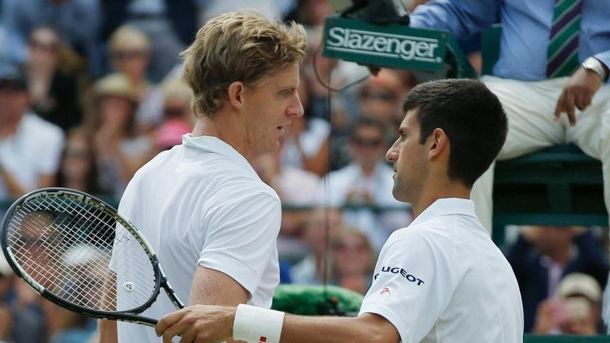 Novak Djokovic of Serbia, right, shakes hands at the net with Kevin Anderson of South Africa, after winning their singles match,  at the All England Lawn Tennis Championships in Wimbledon, London, Tuesday July 7, 2015.  Djokovic won 6-7, 6-7, 6-1, 6-4, 7-5. (AP Photo/Alastair Grant)