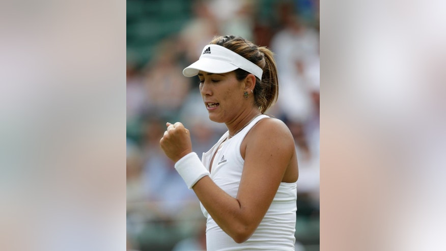 Garbine Muguruza of Spain celebrates winning a point against Timea Bacsinszky of Switzerland during their singles match against at the All England Lawn Tennis Championships in Wimbledon, London, Tuesday July 7, 2015. (AP Photo/Alastair Grant)