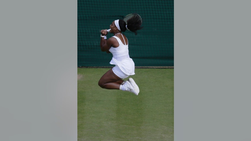 Serena Williams of the United States jumps as she celebrates winning the singles match against Victoria Azarenka of Belarus, at the All England Lawn Tennis Championships in Wimbledon, London, Tuesday July 7, 2015. Williams won 3-6, 6-2, 6-3.  (AP Photo/Pavel Golovkin)
