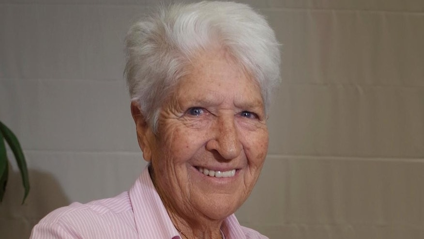 "FILE - In this Oct. 9, 2014, file photo, Australian Olympic swimming great Dawn Fraser  smiles during an interview in Tokyo. Fraser has ""unreservedly apologized"" on Tuesday, July 7, 2015, for her comments in which she suggested that that tennis stars Nick Kyrgios and Bernard Tomic should set a better example or go back to where their parents came from.  Fraser, who won eight Olympic medals including four golds, was speaking in an interview on Australian television Tuesday, when asked about recent petulant behavior by Kyrgios and Tomic.(AP Photo/Haruka Nuga, File)"