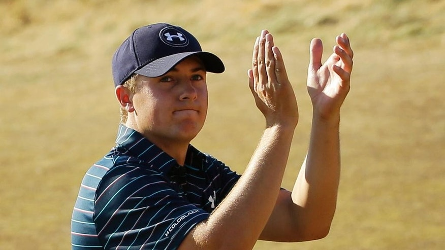 FILE - In this June 21, 2015, file photo, Jordan Spieth claps after finishing the final round of the U.S. Open golf tournament at Chambers Bay in University Place, Wash. Spieth isn't taking the traditional route to the British Open. Rather than prep for St. Andrews in Scotland this weekend, Speith will spend it in the Quad Cities playing the John Deere Classic _ site of his first win as a pro two years ago.   (AP Photo/Ted S. Warren, File)