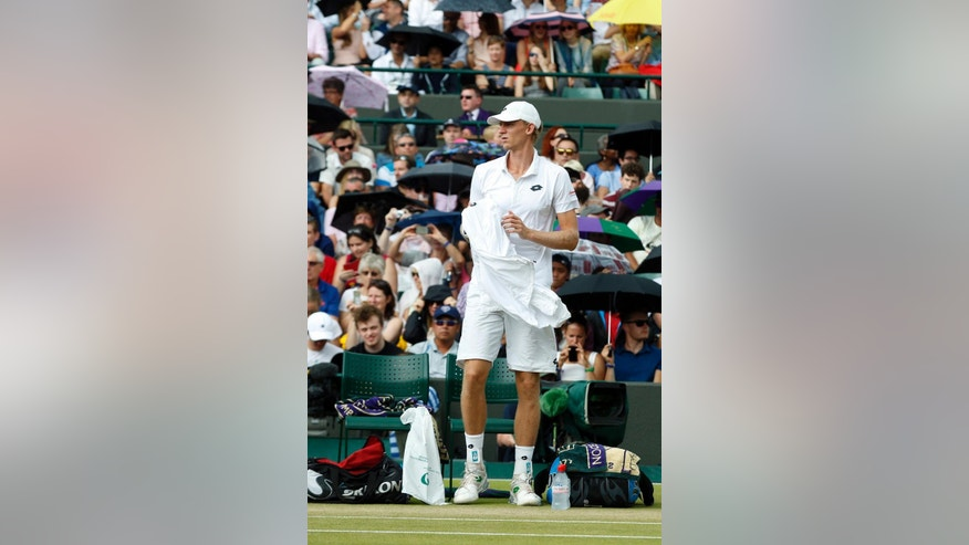 Kevin Anderson of South Africa arrives to resume his singles match against Novak Djokovic of Serbia, at the All England Lawn Tennis Championships in Wimbledon, London, Tuesday July 7, 2015. (AP Photo/Alastair Grant)