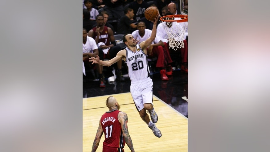 SAN ANTONIO, TX - JUNE 5: Manu Ginobili #20 of the San Antonio Spurs shoots a layup over Chris Andersen #11 of the Miami Heat in Game One of the 2014 NBA Finals.