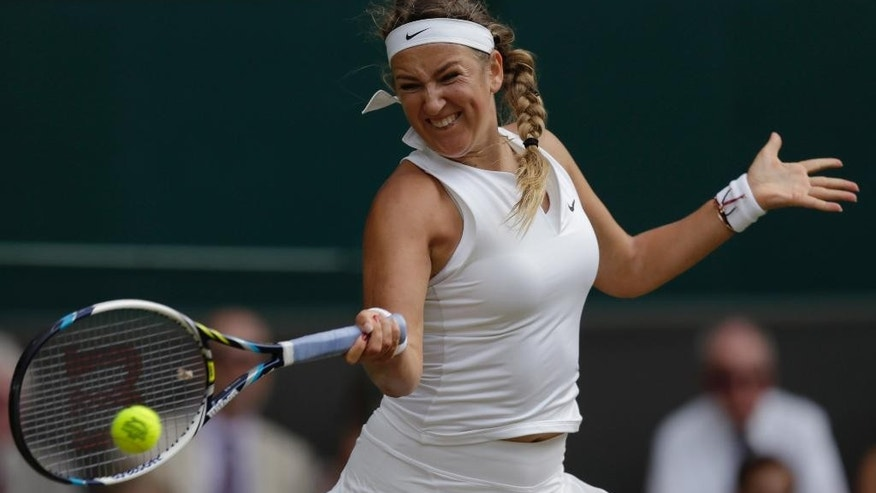 Victoria Azarenka of Belarus makes a return to Serena Williams of the United States  during their singles match at the All England Lawn Tennis Championships in Wimbledon, London, Tuesday July 7, 2015. (AP Photo/Pavel Golovkin)