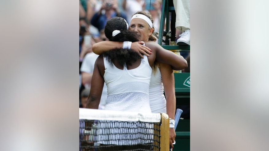 Serena Williams of the United States hugs Victoria Azarenka of Belarus, after defeating her in their singles match, at the All England Lawn Tennis Championships in Wimbledon, London, Tuesday July 7, 2015. Williams won 3-6, 6-2, 6-3.  (AP Photo/Pavel Golovkin)