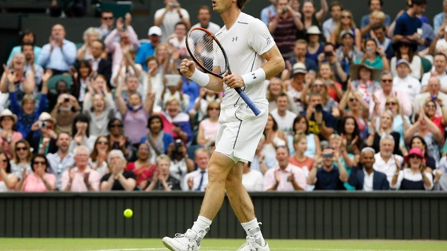 Andy Murray of Britain celebrates at match point as he plays against Vasek Pospisil of Canada, during the men's quarterfinal singles match at the All England Lawn Tennis Championships in Wimbledon, London, Wednesday July 8, 2015. (AP Photo/Kirsty Wigglesworth)