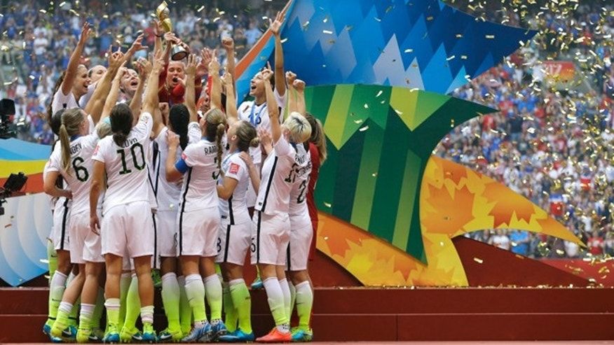 July 5, 2015: The United States Women's National Team celebrates with the trophy as confetti falls after they beat Japan 5-2 in the FIFA Women's World Cup soccer championship in Vancouver, British Columbia, Canada.