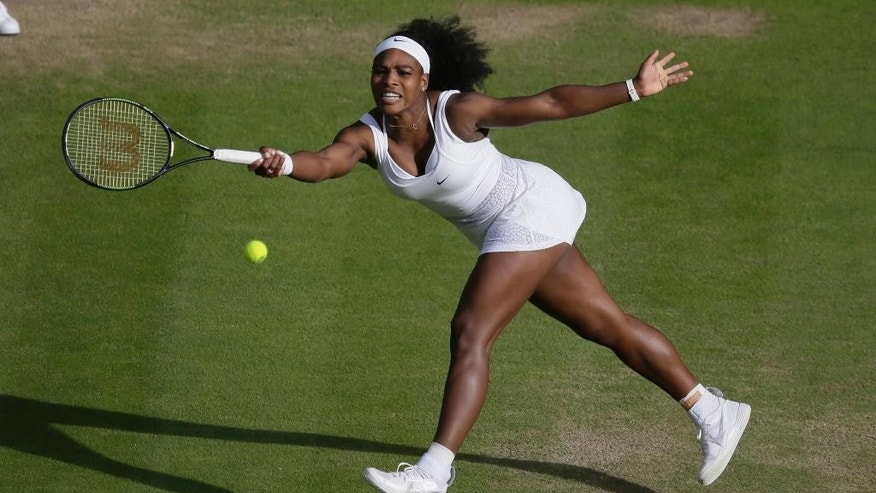 Serena Williams of the United States makes a return to Victoria Azarenka of Belarus  during their singles match at the All England Lawn Tennis Championships in Wimbledon, London, Tuesday July 7, 2015. (AP Photo/Tim Ireland)