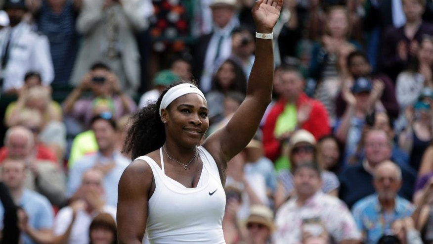 Serena Williams of the United States celebrates winning the singles match against Victoria Azarenka of Belarus, at the All England Lawn Tennis Championships in Wimbledon, London, Tuesday July 7, 2015. Williams won 3-6, 6-2, 6-3.  (AP Photo/Pavel Golovkin)