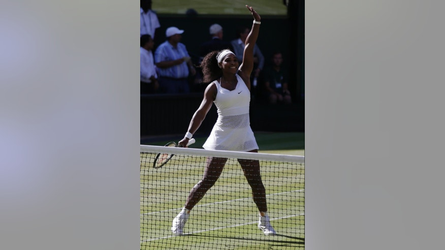 Serena Williams of the United States celebrates as she defeats Maria Sharapova of Russia in their women's singles semifinal match at the All England Lawn Tennis Championships in Wimbledon, London, Thursday July 9, 2015. Williams won 6-2, 6-4. (AP Photo/Pavel Golovkin)