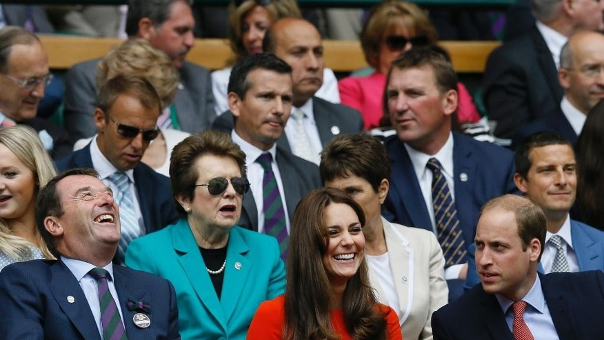 """FILE - In this July 8, 2015 file photo, Britain's Prince William, the Duke of Cambridge right, and Kate, the Duchess of Cambridge sit with the All England Lawn Tennis Club Chairman Philip Brook in the Royal Box on Centre Court, with former Wimbledon Champion Billie Jean King in background, at the All England Lawn Tennis Championships in Wimbledon, London.  King and World Team Tennis are serving up their 40th season, a feat accomplished only by the """"big four"""" U.S. leagues. Starting on Sunday, July 12 through July 29, the newer faces of the coed WTT summer league will take to the courts in seven cities. (AP Photo/Kirsty Wigglesworth, File)"""