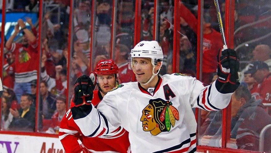 FILE - In this March 23, 2015, file photo, Chicago Blackhawks' Patrick Sharp (10) celebrates his goal, in front of Carolina Hurricanes' Michal Jordan, during an NHL hockey game in Raleigh, N.C. The Blackhawks are sending Sharp and defensive prospect Stephen Jones to the Dallas Stars for veteran defenseman Trevor Daley and forward Ryan Garbutt. (AP Photo/Karl B DeBlaker, File)