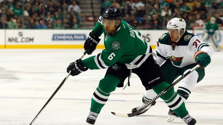 FILE - In this Jan. 3, 2015, file photo, Dallas Stars defenseman Trevor Daley (6) brings the puck down ice, as Minnesota Wild center Kyle Brodziak (21) chases during an NHL hockey game in Dallas. The Chicago Blackhawks are sending Patrick Sharp and defensive prospect Stephen Jones to the Dallas Stars for Daley and forward Ryan Garbutt. (AP Photo/John F. Rhodes, File)