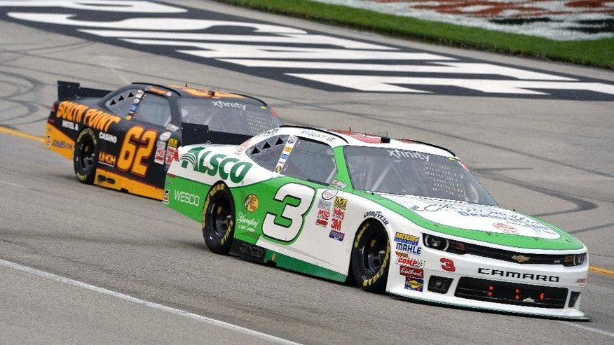 Ty Dillon (3) leads Brendan Gaughan (62) during the NASCAR Xfinity series auto race at Kentucky Speedway in Sparta, Ky., Friday, July 10, 2015. (AP Photo/Timothy D. Easley)