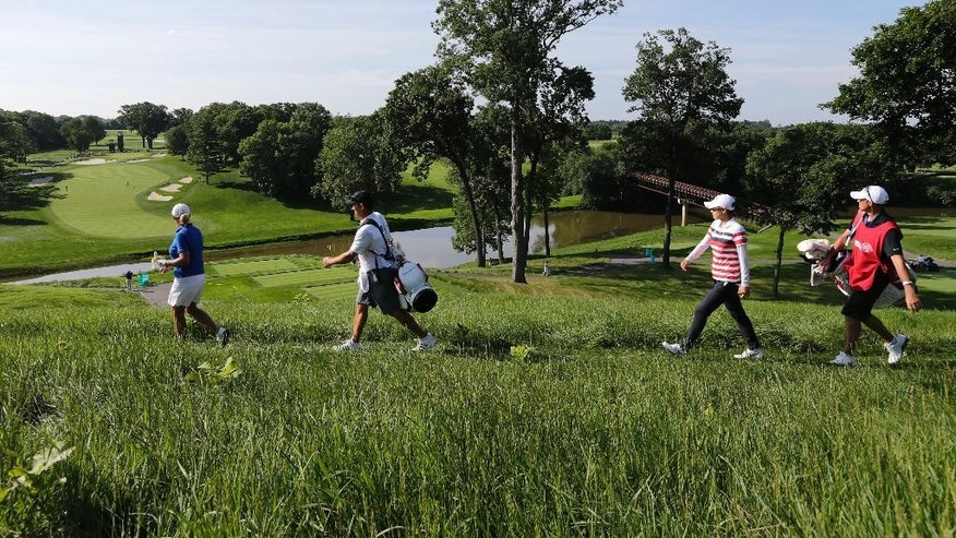 Cristie Kerr, far left, and Na Yeon Choi, second from right, walk down to the third tee during the second round of the U.S. Women's Open golf tournament at Lancaster Country Club, Friday, July 10, 2015 in Lancaster, Pa. (AP Photo/Frank Franklin II)