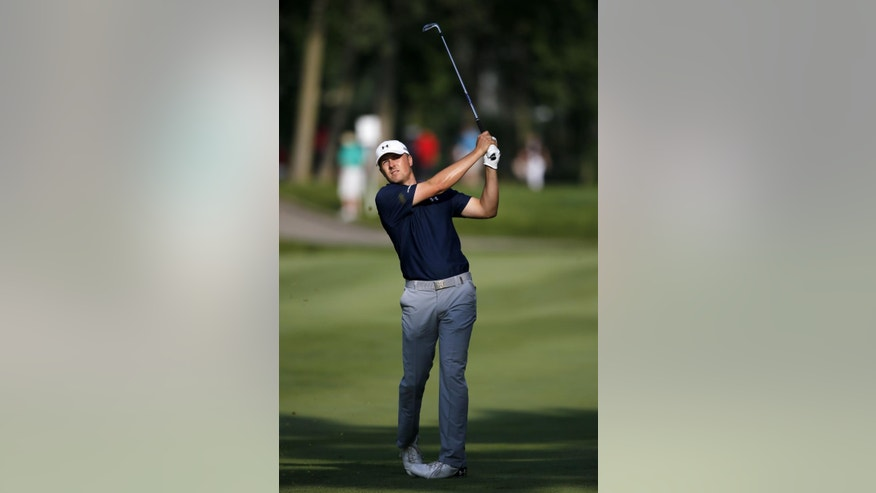Jordan Spieth watches his approach shot on the 11th hole during the second round of the John Deere Classic golf tournament Friday, July 10, 2015, in Silvis, Ill. (AP Photo/Charles Rex Arbogast)