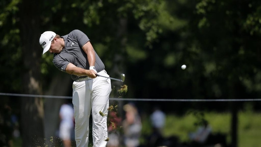 Daniel Summerhays hits his approach shot on the 18th fairway during the second round of the John Deere Classic golf tournament Friday, July 10, 2015, in Silvis, Ill. (AP Photo/Charles Rex Arbogast)