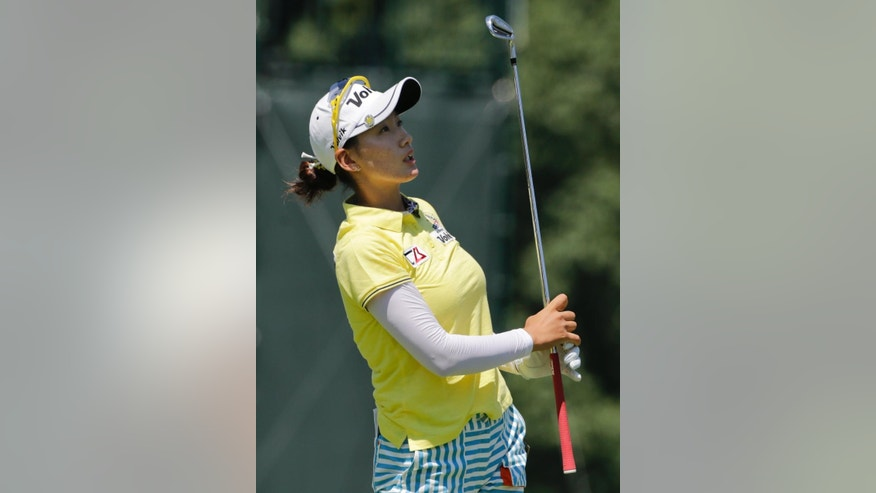 Chella Choi watches her tee shot on the 12th hole during the third round of the U.S. Women's Open golf tournament at Lancaster Country Club, Saturday, July 11, 2015 in Lancaster, Pa. (AP Photo/Frank Franklin II)