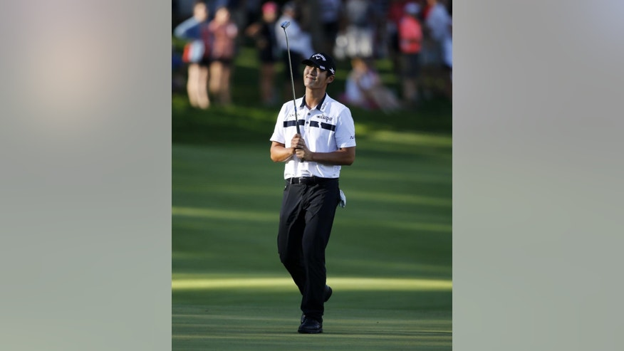 Danny Lee, from New Zealand, reacts after missing a birdie putt on the 18th green during the third round of the John Deere Classic golf tournament Saturday, July 11, 2015, in Silvis, Ill. (AP Photo/Charles Rex Arbogast)