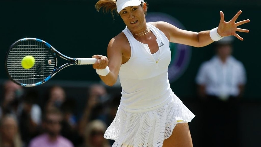 Garbine Muguruza of Spain returns a shot to  Serena Williams of the United States during the women's singles final at the All England Lawn Tennis Championships in Wimbledon, London, Saturday July 11, 2015. (AP Photo/Kirsty Wigglesworth)