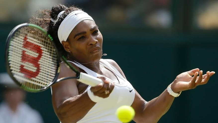 Serena Williams of the United States returns a shot to Garbine Muguruza of Spain, during the women's singles final at the All England Lawn Tennis Championships in Wimbledon, London, Saturday July 11, 2015. (AP Photo/Kirsty Wigglesworth)