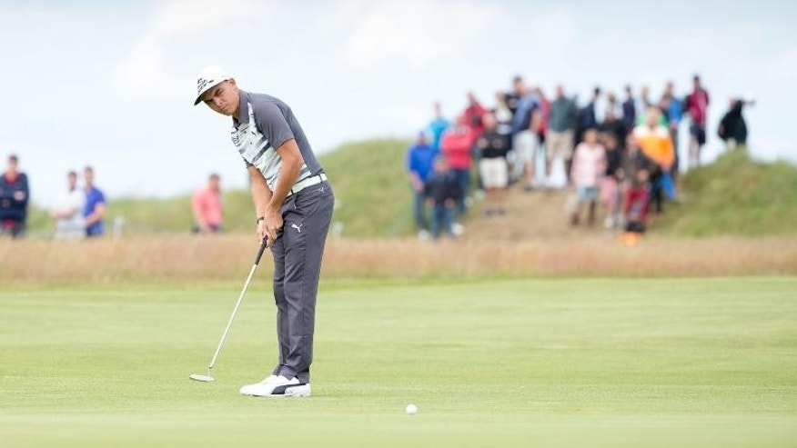 USA's Rickie Fowler putts out at the 9th hole during day three of the Scottish Open at Gullane Golf Club, Gullane, Scotland  Saturday July 11, 2015.  (Kenny Smith/PA via AP) UNITED KINGDOM OUT