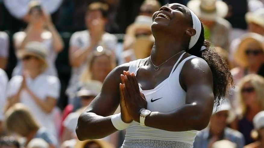 July 11: Serena Williams of the United States  celebrates winning the singles match Garbine Muguruza of Spain after the women's singles final at the All England Lawn Tennis Championships in Wimbledon.