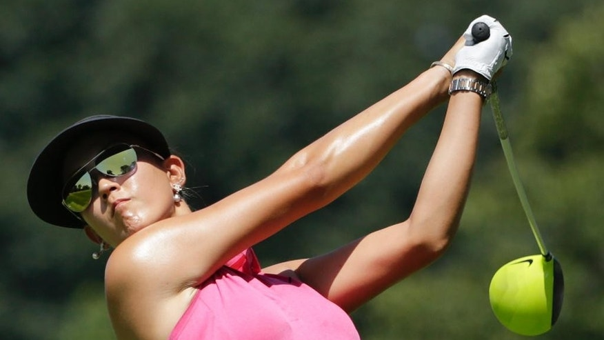 Michelle Wie hits off the ninth tee during the third round of the U.S. Women's Open golf tournament at Lancaster Country Club, Saturday, July 11, 2015 in Lancaster, Pa. (AP Photo/Frank Franklin II)