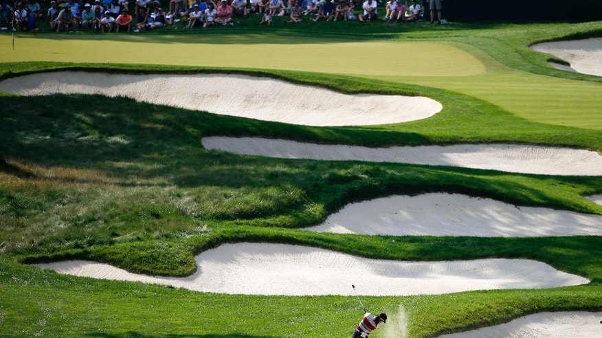 In Gee Chun hits out of a bunker on the 16th fairway during the third round of the U.S. Women's Open golf tournament at Lancaster Country Club, Saturday, July 11, 2015 in Lancaster, Pa. (AP Photo/Gene J. Puskar)