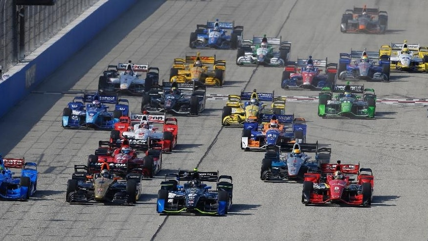 Josef Newgarden (67) leads at the start of the IndyCar Series race at the Milwaukee Mile in West Allis, Wis., Sunday, July 12, 2015. (AP Photo/Jeffrey Phelps)