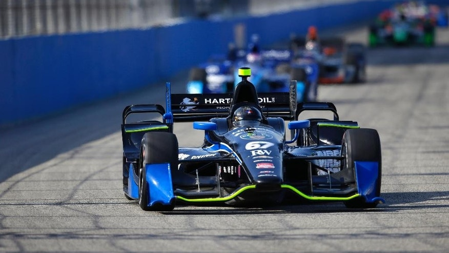 Josef Newgarden leads cars through a turn during the IndyCar Series race at the Milwaukee Mile in West Allis, Wis., Sunday, July 12, 2015.  (AP Photo/Jeffrey Phelps)