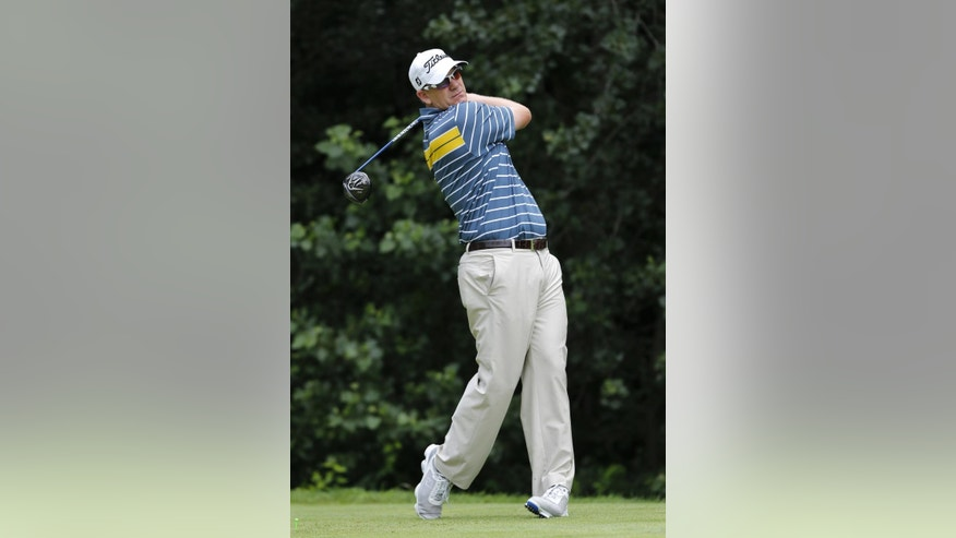 Tom Gillis watches his tee shot on the second hole during the final round of the John Deere Classic golf tournament Sunday, July 12, 2015, in Silvis, Ill. (AP Photo/Charles Rex Arbogast)