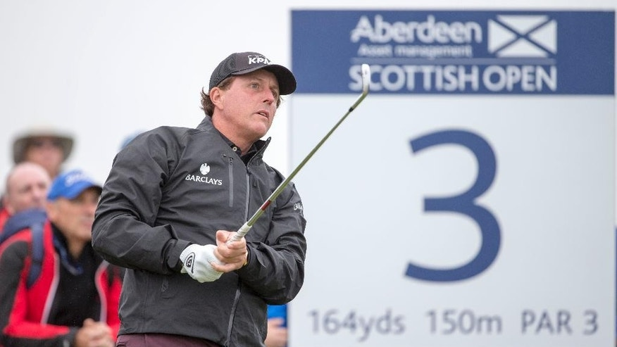 US golfer Phil Mickelson tees off at the 3rd hole during day two of the Scottish Open at Gullane Golf Club, Gullane Scotland  Friday July 10, 2015.  (Kenny Smith/PA via AP) UNITED KINGDOM OUT