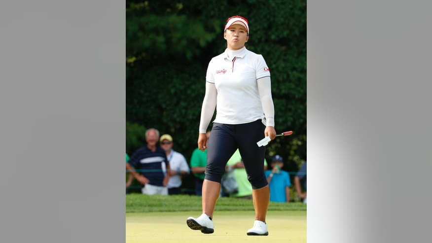 Amy Yang reacts after missing a putt on the 13th green during the final round of the U.S. Women's Open golf tournament at Lancaster Country Club, Sunday, July 12, 2015 in Lancaster, Pa. (AP Photo/Gene J. Puskar)