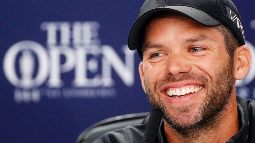 England's Paul Casey  smiles during a press conference during a practice day ahead of The Open Championship 2015 at St Andrews, Scotland  Monday July 13, 2015. Paul Casey had a front-row seat for Louis Oosthuizen's romp to the claret jug the last time the British Open was staged at St. Andrews. As Oosthuizen crossed the Swilcan Bridge on No. 18 on his way to completing an eight-stroke victory in 2010, the player alongside the South African in the final group was Casey  one of Europe's top golfers at the time. (Danny Lawson/PA via AP) UNITED KINGDOM OUT