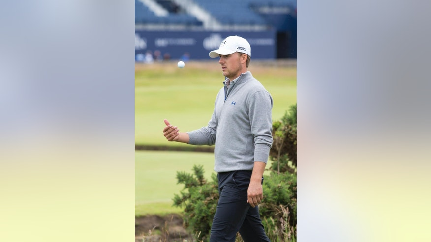 Jordan Spieth of the United States walks to the second tee during a practice round at St Andrews Golf Club prior to the start of the British Open Golf Championship, in St. Andrews, Scotland, Monday, July 13, 2015. (AP Photo/Jon Super)