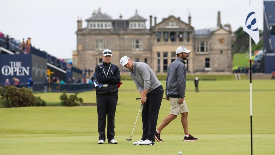 Jordan Spieth of the United States plays a shot on the first green during a practice round at St Andrews Golf Club prior to the start of the British Open Golf Championship, in St. Andrews, Scotland, Monday, July 13, 2015. (AP Photo/Jon Super)