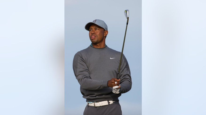 Tiger Woods of the United States watches a shot off the 11th tee during a practice round at St Andrews Golf Club prior to the start of the British Open Golf Championship, in St. Andrews, Scotland, Monday, July 13, 2015. (AP Photo/Jon Super)