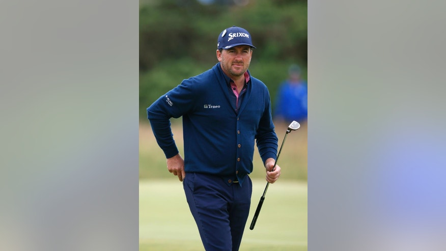 Northern Ireland's Graeme McDowell walks during a practice round at the British Open Golf Championship at the Old Course, St. Andrews, Scotland, Tuesday, July 14, 2015. (AP Photo/Alastair Grant)