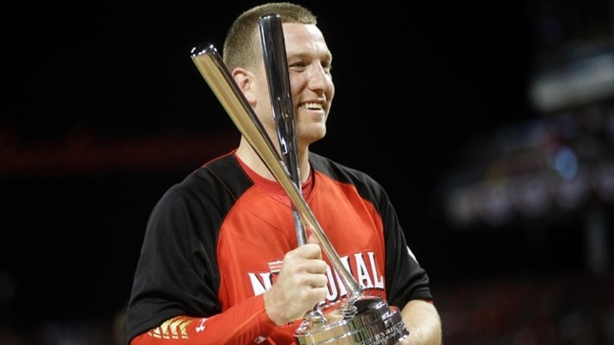 National League's Todd Frazier, of the Cincinnati Reds, holds the trophy after winning the MLB All-Star baseball Home Run Derby, Monday, July 13, 2015, in Cincinnati. (AP Photo/John Minchillo)