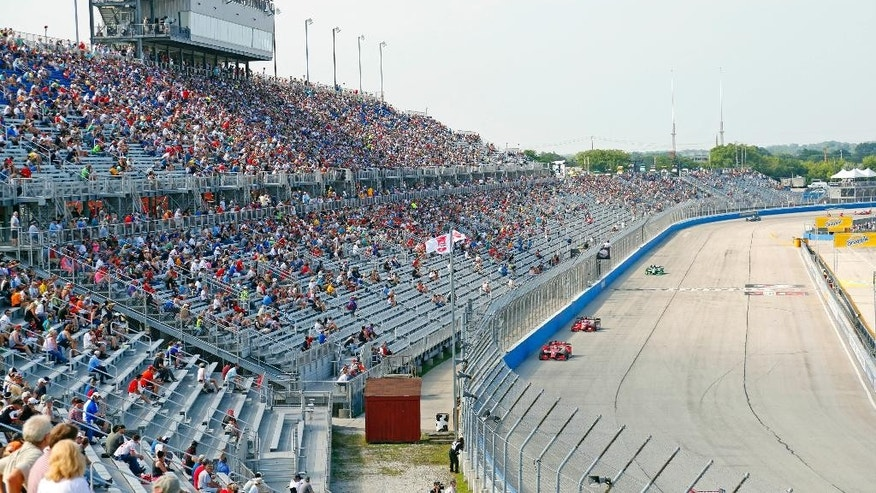 In this July 12, 2015, photo, fans watch the IndyCar Series race at the Milwaukee Mile in West Allis, Wis. Uncertainty looms again at the Milwaukee Mile. The venerable oval has the respect of IndyCar drivers who like the challenge of the flat track. What promoters needed going into this year's IndyCar race was more fans, at least enough of a healthy enough showing to keep the Mile on the IndyCar schedule. By (AP Photo/Jeffrey Phelps)