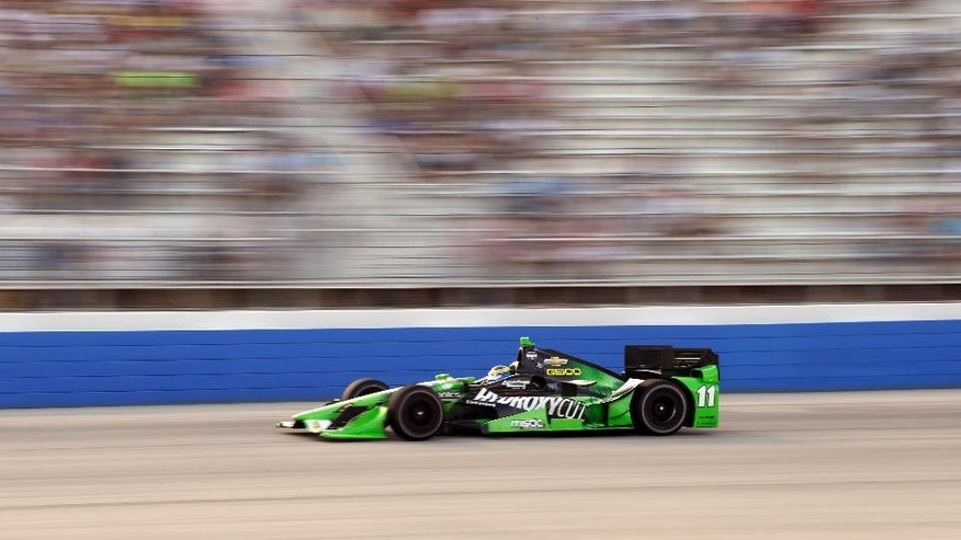 CORRECTS SPELLING TO SEBASTIEN NOT SEBASTIAN Sebastien Bourdais (11) drives during the IndyCar Series race at the Milwaukee Mile in West Allis, Wis., Sunday, July 12, 2015. Bourdais won the race. (AP Photo/Jeffrey Phelps)