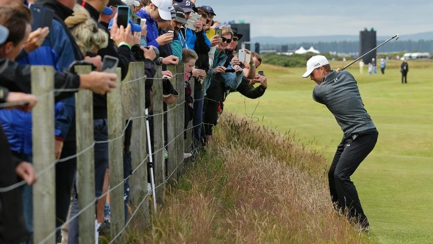 United States' Jordan Spieth plays from the rough on hole 16 during a practice round at the British Open Golf Championship at the Old Course, St. Andrews, Scotland, Wednesday, July 15, 2015. (AP Photo/David J. Phillip)