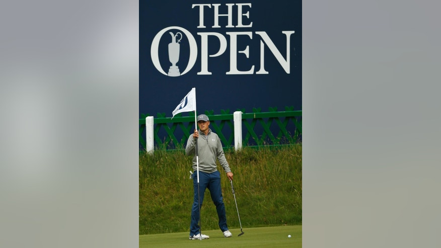 United States' Jordan Spieth holds a pin during a practice round at the British Open Golf Championship at the Old Course, St. Andrews, Scotland, Tuesday, July 14, 2015. (AP Photo/Jon Super)